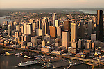 Aerial view of Seattle Skyline along waterfront with ferry boat at pier sunset