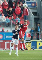 14 April 2012: Toronto FC forward Danny Koevermans #14 and Chivas USA defender Heath Pearce #3 in action during a game between Chivas USA and Toronto FC at BMO Field in Toronto..Chivas USA won 1-0.