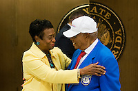 TALLAHASSEE, FLA. 5/3/13-SESSIONEND050313CH-Tuskegee Airman Cornelius Davis, who now lives in Blountstown, right, talks with Sen. Arthenia Joyner, D-Tampa, after being honored for his service during World War II by the Senate, May 3, 2013 at the Capitol in Tallahassee..COLIN HACKLEY PHOTO