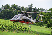 A helicopter carrying Donald Trump, a candidate for the 2016 Republican nomination for President of the United States, arrives at the Albemarle Estate at the Trump Winery in Charlottesville, Virginia on Tuesday, July 14, 2015.   Trump was in Virginia to appear at the ribbon cutting for the new business venture.<br /> Credit: Ron Sachs / CNP<br /> <br /> (RESTRICTION: NO New York or New Jersey Newspapers or newspapers within a 75 mile radius of New York City)