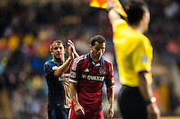 Daniel Cruz (44) of the Philadelphia Union and Dilly Duka (8) of the Chicago Fire react to a call. The Philadelphia Union defeated the Chicago Fire 1-0 during a Major League Soccer (MLS) match at PPL Park in Chester, PA, on May 18, 2013.