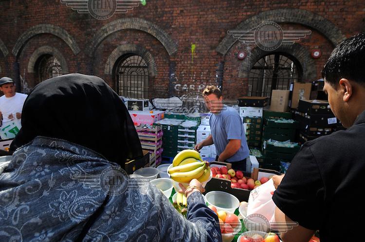 Fruit stall at Brick Lane market. Brick Lane is the heart of the city's Bangladeshi community.