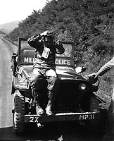 North Korean prisoner of Marines who rolled enemy back in Naktong River fighting.  He wear a &quot;Prisoner of War&quot; tag and was treated in accordance with United Nations' rules of international warfare.  September 4, 1950.  S. Sgt. Walter W. Frank.  (Marine Corps)<br /> NARA FILE #:  127-N-A2122<br /> WAR &amp; CONFLICT BOOK #:  1491