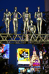 "Shinjuku Bright Lights - Metallic sculptures overlooking traffic at Yasukuni Street in Shinjuku - one of the main shopping and train terminals of Tokyo. This is Kabukicho an entertainment and red-light district in Shinjuku.. Kabukicho is the location of many hostess bars, host bars, love hotels, shops, restaurants, and nightclubs, and is often called the ""Sleepless Town"". The district's name comes from a 1940s plan to build a kabuki theater: although the theater was never built the name stuck."