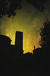 Silhouette of buildings in Italy with yellow sunset
