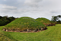 Detail of two satellite mounds showing of kirbstones, Great Mound, Knowth, c. 3000 BC, Bru na Boinne, County Meath, Ireland. The megalithic Great Mound was probably built after Newgrange and before Dowth. Similar in size to Newgrange it is surrounded by 18 smaller satellite mounds. Picture by Manuel Cohen