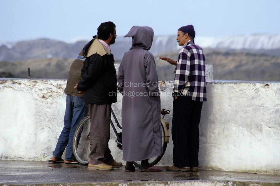 Essaouira, Morocco - Three Moroccan Men in Conversation.