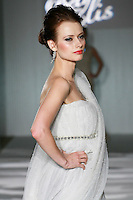 Model walks the runway in a Beth Elis Lumina wedding dress by Nere Emiko during the Wedding Trendspot Spring 2011 Press Fashion, October 17, 2010.