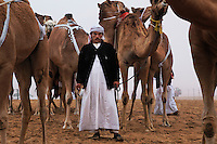 Favored camels can bring their owners fantastic sums, but the hired trainers enjoy a special relationship with their charges, forged on long migrations to seasonal grazing lands.