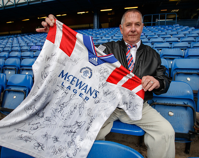 """The Bear Hunter"" John Irwin at Ibrox along with his shirt with all the signatures of Rangers nine in a row players"