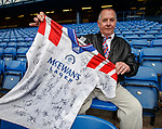"""""""The Bear Hunter"""" John Irwin at Ibrox along with his shirt with all the signatures of Rangers nine in a row players"""