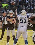 Oakland Raiders quarterback Derek Carr (4) passes ball over Indianapolis Colts defensive tackle Hassan Ridgeway (91) on Saturday, December 24, 2016, at O.co Coliseum in Oakland, California.  The Raiders defeated the Colts 33-25.