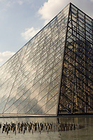 PARIS, FRANCE - AUGUST 25 : A low angle view of the pyramid at the Louvre on August 25, 2007 in Paris, France. The pyramid was designed by the American architect I M Pei and opened to the public in 1989 for the bicentennial of the French Revolution. Built of 666 glass lozenges on a steel frame,  the pyramid forms the main entrance of the Louvre museum. (Photo by Manuel Cohen)