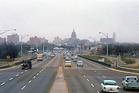 Vintage view of the Interstate 35 highway traffic leading into downtown, Austin, Texas Capitol city with vintage cars and trucks of the period in March, 1963 - Stock Image.