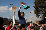 Egyptian volunteers with brooms replace protesters as they go to remove dust and rubble from the area around Tahrir Square February 12, 2011 in Cairo, Egypt. The day after the revolution toppled the regime of President Hosni Mubarak, Egyptians continued to celebrate and began to focus on rebuilding their city and society. (Photo by Scott Nelson)