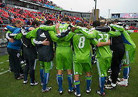 25 April 2010:   Seattle Sounders players huddle before the start of a game between the Seattle Sounders and Toronto FC at BMO Field in Toronto..Toronto FC won 2-0....