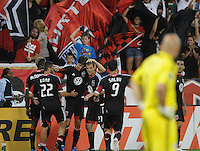 D.C. United defender Dejan Jakovic (8) celebrates his teammates his score in the 45th minutes of the game while New England Revolution goalkeeper Matt Reis (1) looks with despair. D.C. United defeated The New England Revolution 3-2 at RFK Stadium, Saturday May 26, 2012.