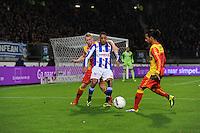 VOETBAL: ABE LENSTRA STADION: HEERENVEEN: 30-11-2013, SC Heerenveen - Go Ahead Eagles, uitslag 3-1, Doke Schmidt (#12 | GAE), Rajiv van La Parra (#7 | SCH), Jarchinio Antonia (#7 | GAE), ©foto Martin de Jong