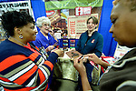 Bekah Forni of Equal Exchange hands out samples of fair trade chocolate to appreciative participants at the United Methodist Women Assembly in the Kentucky International Convention Center in Louisville, Kentucky, on April 25, 2014.