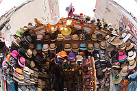 Hats on display at a kiosk  on Broadway in the Noho neighborhood in New York on Friday, May 25, 2012. (© Frances M. Roberts)