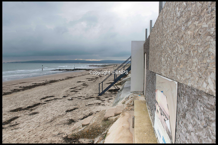 BNPS.co.uk (01202 558833)<br /> Pic: LauraDale/BNPS<br /> <br /> Boarded up: The back of the plot, facing out onto Sandbanks beach.<br /> <br /> A narrow empty plot of land in the world-renowned Sandbanks area is on the market for &pound;6.25million.<br /> <br /> The piece of land is worth &pound;2m more now its empty than it was when the owner bought it with two semi-detached houses on it.<br /> <br /> The area in Dorset, often called Millionaire's Row, is said to be the fourth most expensive place in the world to live and this plot is one of the few left to redevelop.