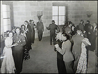 BNPS.co.uk (01202 558833)<br /> Pic: Marlows/BNPS<br /> <br /> The wedding lasted for three days despite the war turning against the Nazi's.<br /> <br /> Taken just three days before D-Day this remarkable photo shows Adolf Hitler celebrating the wedding of his brother-in-law - who he had executed a year later.<br /> <br /> The previously unseen image shows the Nazi dictator congratulating Hermann Fegelein and bride Gretl Braun, little realising that the course of the Second World War was about to turn against him.<br /> <br /> It was found in a gallery of 12 snaps of the wedding reception that lasted for thee days and was organised by Eva Braun, the elder sister of Gretl and Hitler's mistress.<br /> <br /> The fuhrer was one of the witnesses to the marriage along with SS chief Heinrich Himmler and Martin Bormann, Hitler's private secretary.<br /> <br /> The 12 black and white photos taken at her first wedding have sold at Marlows auctioneers of Stafford for &pound;400.