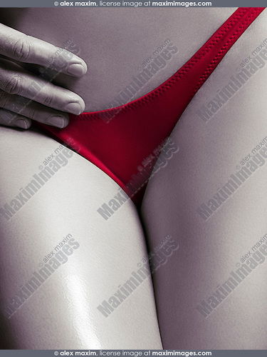 Closeup of man hand on sexy woman body in red underwear