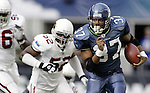 Seattle Seahawks'  running back Shaun Alexander rushes against the Cardinals on Sunday, Sept. 17, 2005 at QWEST Field in Seattle. Jim Bryant Photo. ©2010. All Rights Reserved.