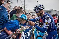 E3 victory champion (with 5 wins) Tom Boonen (BEL/Quick-Step Floors) signing a young boys cap at the start of his last E3<br /> <br /> <br /> 60th E3 Harelbeke (1.UWT)<br /> 1day race: Harelbeke &rsaquo; Harelbeke - BEL (206km)