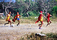 BURMA (MYANMAR) Shan State, Nyaungshwe, Inle Lake. 2006. An afternoon football match between monks, some sharing shoes or not wearing them at all.
