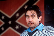 Region of Huntsville, AL - December 6th and 7th 1980<br /> Bill Wilkinson the Wizard of the Invisible  Empire of the KKK (Portrait). There's a camp of Special Forces of the KKK. <br /> We are a small group of journalists invited to witness their training Deep in a forest of Alabama, bordering Tennessee, training ground for the Ku Klux Klan&rsquo;s secret army R&eacute;gion de Huntsville, Alabama. 6 et 7 d&eacute;cembre 1980.<br /> Nous sommes un petit groupe de journalistes invit&eacute;s &agrave; un entra&icirc;nement des troupes arm&eacute;es du Ku Klux Klan. On nous a band&eacute; les yeux et nous avons d&ucirc; passer une nuit dans la for&ecirc;t pour assister au petit matin &agrave; un exercice militaire et de tirs d'un groupe arm&eacute; et cagoul&eacute;. On nous a dit que dans cet &eacute;tat ils avaient le droit d'avoir des armes et de s'entra&icirc;ner, non pas &agrave; tuer mais &agrave; d&eacute;fendre la culture de la race blanche.