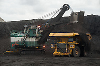 Pouring 50 tons at a time, a shovel loads coal into a giant, 25-foot-tall dump truck at the Spring Creek Mine, a Cloud Peak Energy property in southern Montana, Friday, May 17, 2013. Pending new ports for shipment to Asia through either the U.S. or Canada, Cloud Peak Energey hopes to open new high-grade coal mines on and near the Crow Reservation in southern Montana. The tribe is equally hopeful the new mines would bring long-awaited economic stability to the tribe. (Kevin Moloney for the New York Times)