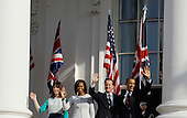 U.S. President Barack Obama (R), British Prime Minister David Cameron (2nd R), First Lady Michelle Obama (2nd L), and Samantha Cameron wave during an official arrival ceremony at the South Lawn of the White House March 14, 2012 in Washington, DC. Prime Minister Cameron was on a three-day visit in the U.S. and he was expected to have talks with President Obama on the situations in Afghanistan, Syria and Iran. .Credit: Chip Somodevilla / Pool via CNP