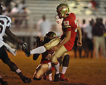 Lafayette High's Casey Vaughn (33) kicks an extra point as Lafayette High's Brandon Mack (4) holds vs. Greenwood in Oxford, Miss. on Friday, August 24, 2012. Lafayette won 41-0.
