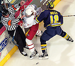- Omaha, Neb. 2/22/2003 University of Nebraska at Omaha's Josh Weeks  and University of  Michigan's David Moss colide into Referee Kevin Hall at the Omaha Civic Auditorium Saturday evening (Chris Machian/Prairie Pixel Group)