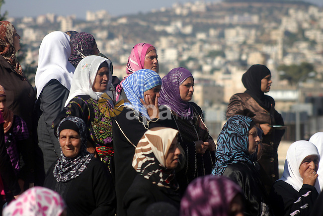 Palestinian Muslims wait at an Israeli checkpoint on the outskirts of the West Bank city of Bethlehem on August 19, 2011 as they wait to cross into Jerusalem to attend on their way to pray at the Al Aqsa Mosque on the third Friday of the Muslim holy month of Ramadan.Muslims around the world are observing the holy fasting month of Ramadan where they refrain from eating, drinking and smoking from dawn to dusk. Photo by Najeh Hashlamoun