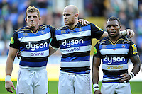 Stuart Hooper, Matt Garvey and Semesa Rokoduguni of Bath Rugby line-up prior to the match. Aviva Premiership match, between London Irish and Bath Rugby on November 7, 2015 at the Madejski Stadium in Reading, England. Photo by: Patrick Khachfe / Onside Images