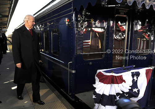 Wilmington, DE - January 17, 2009 -- United States Vice President-elect Joe Biden prepares to join President-elect Barack Obama on the train in Wilmington, Delaware, on the Whistle Stop Train Tour, on Saturday, January 17, 2009. The ceremonial trip will carry President-elect Obama, Vice President-elect Biden and their families to Washington for their inaugurations with additional events in Philadelphia, Wilmington and Baltimore. Obama will be sworn in as the 44th President of the United States on January 20, 2009. .Credit: Kevin Dietsch - Pool via CNP