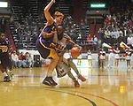 "Ole Miss guard Chris Warren (12)  vs. Louisiana State's Eddie Ludwig (13) at the C.M. ""Tad"" Smith Coliseum in Oxford, Miss. on Wednesday, February 9, 2011. Ole Miss won 66-60 and is now 4-5 in the Southeastern Conference."