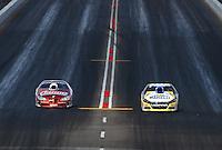 Feb 22, 2015; Chandler, AZ, USA; NHRA pro stock driver Allen Johnson (right) races alongside Jimmy Alund during the Carquest Nationals at Wild Horse Pass Motorsports Park. Mandatory Credit: Mark J. Rebilas-