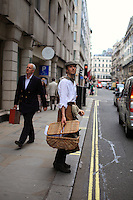 Steve Benbow in a beekeeping outfit on Jermyn Street next to Piccadilly.
