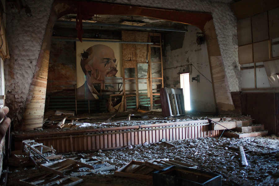 Kharsavey,Yamal Peninsula, Russia, 10/07/2010..Lenin backdrop onstage inside the dilapidated House of Culture of the Karsk Expedition, the last attempt to colonise the Russian Arctic,  abandoned during the 1997 Russian financial crisis.