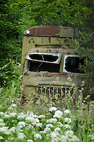Broumov, Giant Mountains, Northern Bohemia, Czech Republic, June 2010. An old Praga Truck is left to rot at a former communist socialist collective farm. The area around Teplice, also known as the Broumovsky Steny, was inhabited by ethnic Sudeten Germans, that were deported after the Second World War. The rural landscape with green fields and cattle is dotted with little villages scarred by communist socialist architecture. Photo by Frits Meyst/Adventure4ever.com
