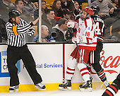 Jack Millea, Wade Megan (BU - 18), Dax Lauwers (NU - 44) - The Northeastern University Huskies defeated the Boston University Terriers 3-2 in the opening round of the 2013 Beanpot tournament on Monday, February 4, 2013, at TD Garden in Boston, Massachusetts.