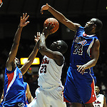 SMU's Shawn Williams (2) fouls Mississippi's Reginald Buckner (23) as SMU's Robert Nyakundi (24) also defends at the C.M. &quot;Tad&quot; Smith Coliseum in Oxford, Miss. on Tuesday, January 3, 2012. Mississippi won 50-48. (AP Photo/Oxford Eagle, Bruce Newman)