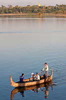 Myanmar, Burma, Mandalay.  Taungthaman Lake.  Two Burmese Landies Emjoying an Afternoon on the Lake.