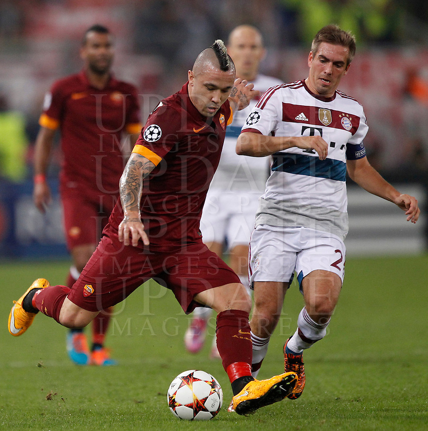 Calcio, Champions League, Gruppo E: Roma vs Bayern Monaco. Roma, stadio Olimpico, 21 ottobre 2014.<br /> Roma&rsquo;s Radja Nainggolan is challenged by Bayern&rsquo;s Philipp Lahm, right, during the Group E Champions League football match between AS Roma and Bayern at Rome's Olympic stadium, 21 October 2014.<br /> UPDATE IMAGES PRESS/Isabella Bonotto