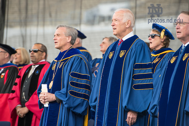May 15, 2016; University of Notre Dame president Rev. John Jenkins, C.S.C., stands with Laetare Medal recipient Vice President Joe Biden at the opening of the 2016 Commencement ceremony at Notre Dame Stadium.(Photo by Barbara Johnston/University of Notre Dame)