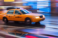 Motion blurred abstraction of taxi rushing through Times Square