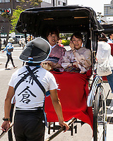 Two ladies in Kimonos on a Rickshaw ride in  Kamakura Japan